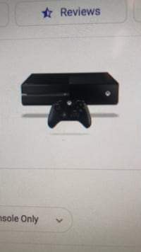 Black xbox one console with controller New Port Richey, 34653