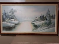 body of water beside snow filled islands painting