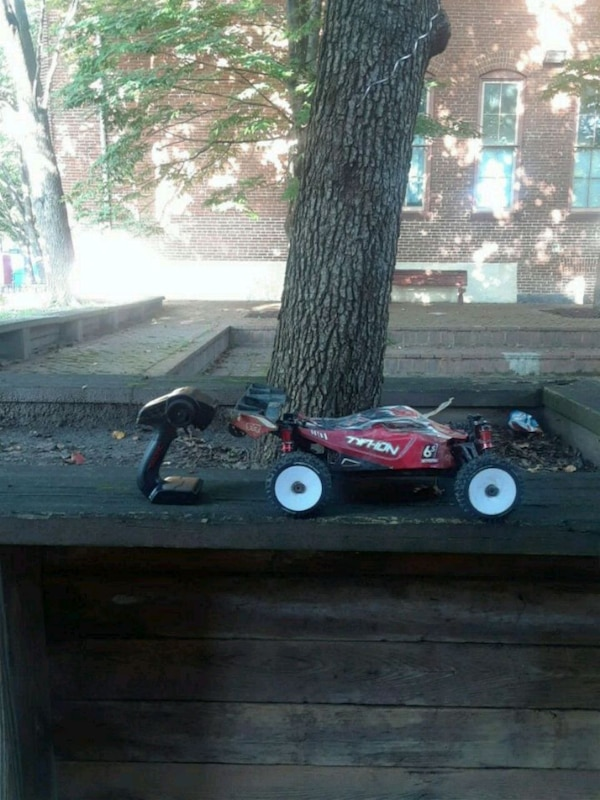 red and black RC car 8th scale n more