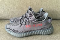 pair of gray Adidas Yeezy Boost 350 V2 545 km