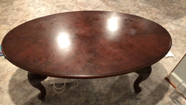 oval brown wooden coffee table