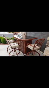 Like brand new! Metal but shows like wood finish with solid granite top. 4 bar chairs also like new! No tears or stains! Las Vegas, 89149