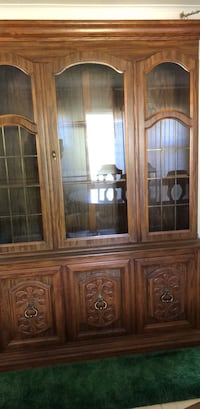 brown wooden framed glass china cabinet Newburgh, 12550