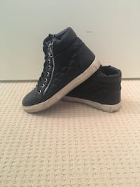 Pair of black high-top sneakers size 7