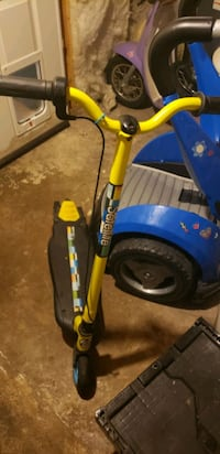 Ride on electric scooter