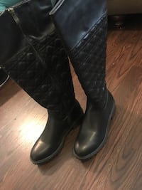 pair of quilted black leather knee-hi boots