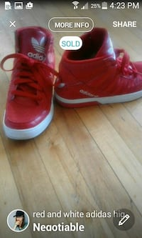 pair of red and white adidas high top sneakers London, N5Y