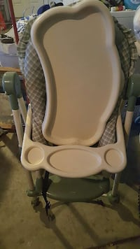 baby's green and white high chair