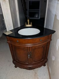 Bathroom corner vanity with sink and faucet