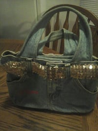Small Jean purse with  the  name  Pam embroidered. Ringgold, 30736