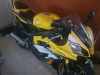 yellow and black sports bike Mobile