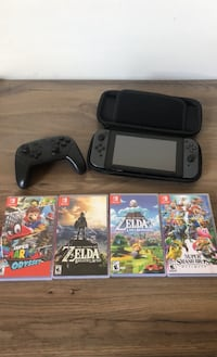 Nintendo switch, 4 games, case and pro controller