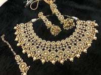 gold-colored bib necklace and earrings