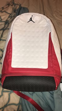 white and red Air Jordan backpack