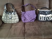 two pink and black leather handbags 796 km