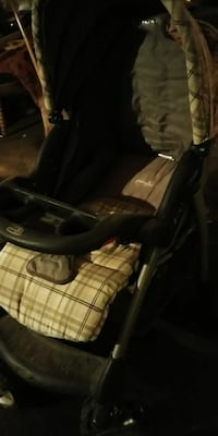 infant's brown and black Evenflo stroller