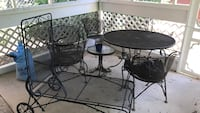 Round black metal patio table with chairs Baltimore, 21225