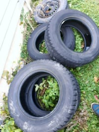 two black vehicle tires with text overlay North York, M2M