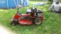 Red and black Snapper ride on lawn mower