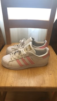 pair of white Adidas low-top sneakers New York, 10461