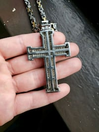 silver-colored cross pendant New York, 10009