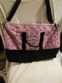 brown and black leather tote bag 865 mi