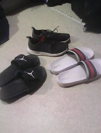 pair of black-and-white slide sandals 3733 km
