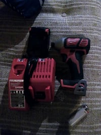 black and red Milwaukee cordless impact wrench Regina, S4T