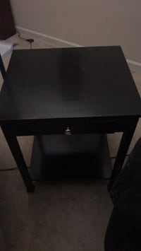 End table with pull out drawer. $25.00 310 mi