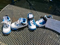 two pairs of blue and white Nike basketball shoes Raytown, 64133