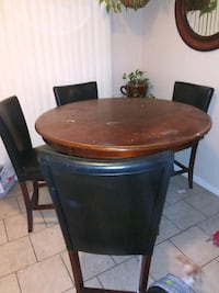 round brown wooden table with four chairs dining set Bellflower, 90706