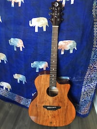 Gently used acoustic-electric guitar
