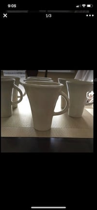 7- matching tall beige mugs