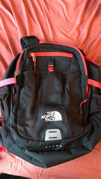 Pink and dark gray the north face backpack Des Moines, 50321