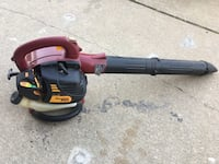 maroon and black Poulan Pro gas leaf blower