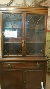 brown wooden framed glass display cabinet St. Louis