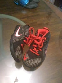 pair of black-and-red Nike running shoes Canton, 44721