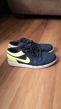 Pair of black-and-yellow Nike low tops Alexandria, 22304