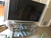 Glass tv stand asking $50 for it also have a box tv only think wrong is it needs a bulb asking 20for it Vidor, 77662