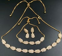 gold-colored necklace and earrings Repentigny, J6A 7V9