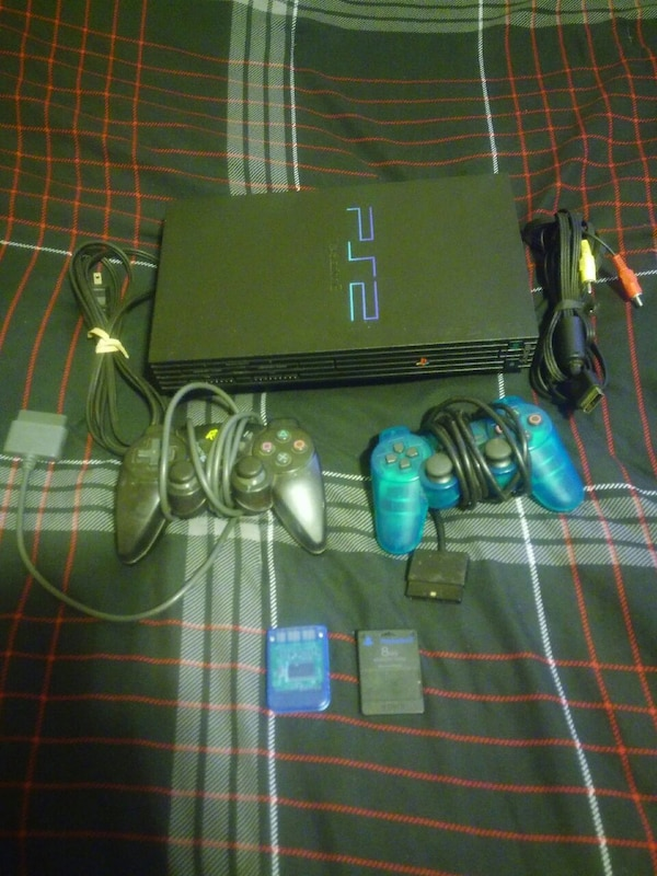 black Sony PS2 with two corded controllers