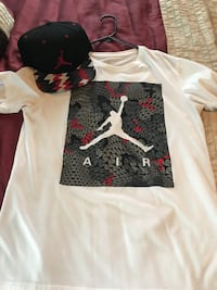 White and gray air jordan crew-neck shirt and black cap