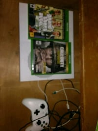 Xbox One console with controller and game cases 609 mi