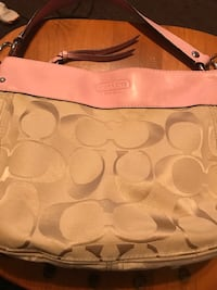 monogrammed brown and pink Coach canvas and leather hobo bag