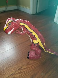 red and yellow plastic toy dinosaur