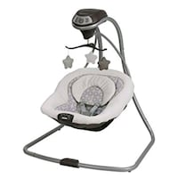 baby's white and black Graco cradle and swing Spring, 77389