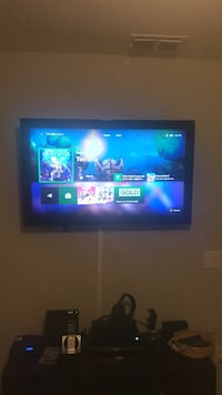 black flat screen TV with remote Palm Bay, 32907