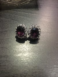 pair of silver-colored and red gemstone stud earrings