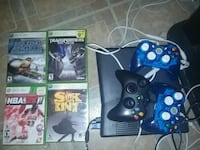black Xbox 360 console with controllers and game cases Montréal, H4H 1J3