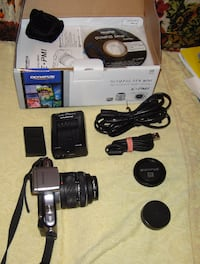 gray and black DSLR camera with battery charger